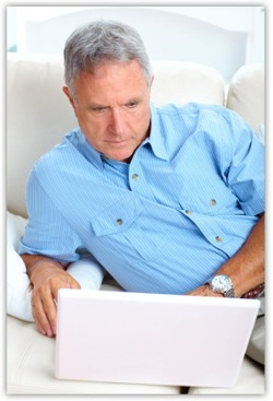Man on computer looking up cancer information