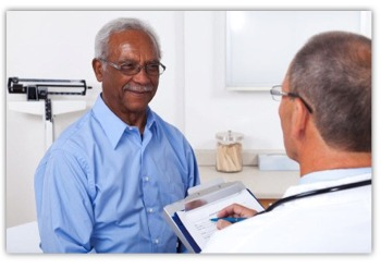 man talking with Doctor about cancer treatments and technology
